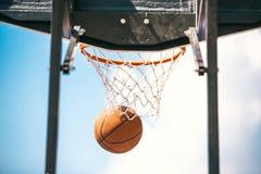 A basketball ball in a ring. Closeup photo royalty free stock photos