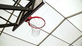 Basketball ball successfully flying into basketball ring. Lot basketball balls fly into basketball hoop. Sports training. Hit ball in net stock footage