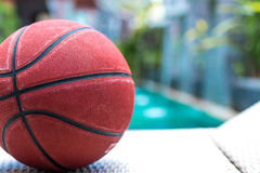 Basketball ball on a swimming pool background, tropical sport scene. Basketball ball on a swimming pool background, sport scene royalty free stock photography