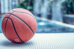 Basketball ball on a swimming pool background, tropical sport scene. Basketball ball on a swimming pool background, sport scene royalty free stock image