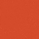 Basketball ball texture. Orange rubber coating with pimples. Sea Royalty Free Stock Photos