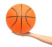Basketball ball on woman hand isolated on white Stock Image