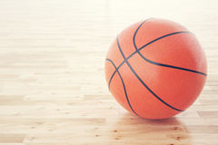 Basketball ball on the wooden floor, with depth of field effect. 3d rendering Royalty Free Stock Photography