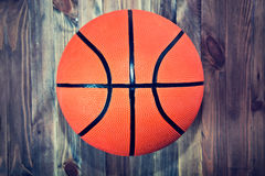 Basketball ball on wooden hardwood floor. Royalty Free Stock Images
