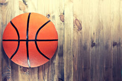 Basketball ball on wooden hardwood floor. Royalty Free Stock Photography