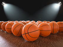 Basketball balls. 3d rendering basketball balls on wooden floor with shining lights Stock Images