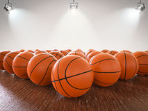 Basketball balls. 3d rendering basketball balls on wooden floor with shining lights stock image