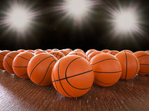 Basketball balls. 3d rendering basketball balls on wooden floor with shining lights Royalty Free Stock Photo