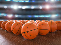 Basketball balls. 3d rendering basketball balls on wooden floor with shining lights Stock Photos