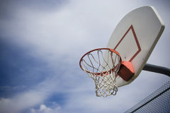 Basketball Basket. An outdoor basketball basket with the simple backdrop of a cloudy day. Lots of Copy space Stock Photography