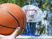 Basketball on a basket background Royalty Free Stock Photo