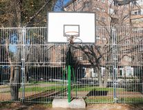 Basketball basket with broken net stock images