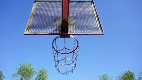 Basketball basket with chains on streetball court stock video footage