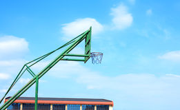 Basketball basket on cloudy blue sky background Royalty Free Stock Photography