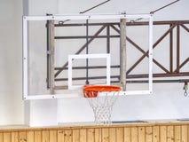 Basketball basket on frame. School gym with basketball board