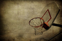 Basketball Basket Grunge. A grunge basketball basket background. Lots of Copy space room and cool sepia filter feel Royalty Free Stock Photography