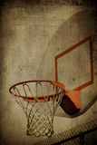 Basketball Basket Grunge. A grunge basketball basket background. Lots of Copy space room and cool sepia filter feel Stock Photos