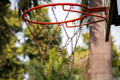 Basketball Basket. Red Basketball Basket with chains.Nice blured background with lots of bokeh Stock Image