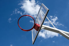 Basketball basket on sky background. Basketball under the open sky, against the sky, view from below Stock Image