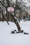Basketball basket in snow Stock Photo
