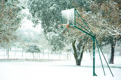 Basketball basket in snowy field stock images
