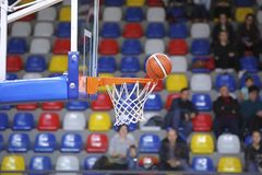 The basketball basket in sport hall. The basketball basket in the sport hall with tribune on background Royalty Free Stock Photos