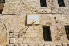 Basketball basket on the wall of monastery. Outdoor activity loc Stock Images