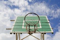 A basketball basket on weathered green wooden facade. Basketball. Hoop stock photography