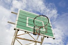 A basketball basket on weathered green wooden facade. Basketball. Hoop royalty free stock image