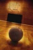 Basketball and Basketball Court. Basketball on floor of empty basketball court Stock Image