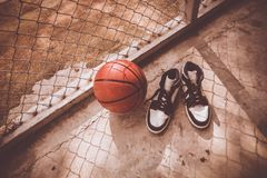 Basketball. Court with ball and shoes stock images