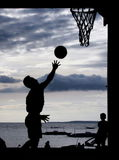 Basketball on the beach. Playing basketball during sunset at the Philippines Royalty Free Stock Photography