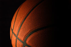 Basketball on Black. A dramatic image of a basketball on black Royalty Free Stock Photography