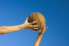Basketball block. A ball is being blocked by another during a basketball game Royalty Free Stock Photos