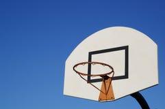 Basketball in the blue sky. Basketball hoop under the blue sky Stock Photos