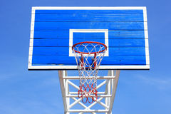 Basketball board with hoop. On blue sky background Royalty Free Stock Image