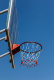 Basketball board and hoop with blue sky. Royalty Free Stock Images