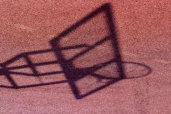 Basketball board and net shadow on the basketball court ground.  Stock Photos