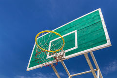 Basketball board with yellow hoop Stock Images