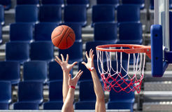 Basketball bounce. Basketball action fighting for the bounce Royalty Free Stock Photos