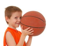Basketball Boy 13. Young boy playing with a basketball isolated on white Stock Photography