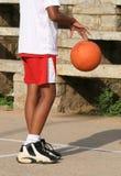 Basketball Boy. A young boy (10-12) dribbling a basketball Stock Image