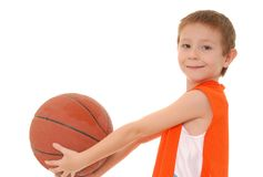 Basketball Boy 4. Young boy playing with a basketball isolated on white Stock Photos