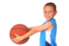 Basketball Boy. Young boy playing with a basketball isolated on white Stock Images