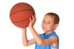Basketball Boy. Young boy playing with a basketball isolated on white Royalty Free Stock Image