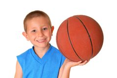 Basketball Boy. Young boy playing with a basketball isolated on white Royalty Free Stock Images