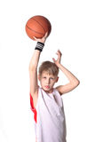 Basketball boy. A 10 year old boy concentrating before a shooting a basketball stock photo