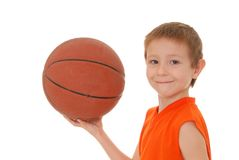 Basketball Boy 7. Young boy playing with a basketball isolated on white Stock Photos