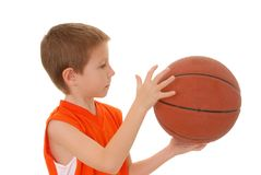 Basketball Boy 8. Young boy playing with a basketball isolated on white Royalty Free Stock Photography