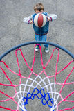 Basketball boy. Boy playing basketball photographed from above the ring Stock Image